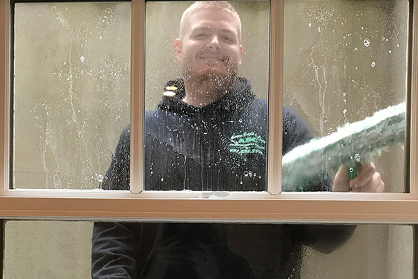 Joe cleaning a residential window.
